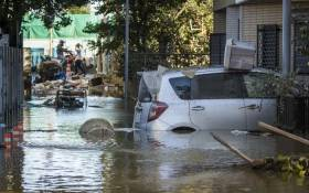 Flooded vehicles are seen in the aftermath of Typhoon Hagibis in Kawasaki on October 13, 2019. Japan's military scrambled October 13 to rescue people trapped by flooding in the aftermath of powerful Typhoon Hagibis, which killed at least four people, caused landslides and burst rivers. Picture: AFP