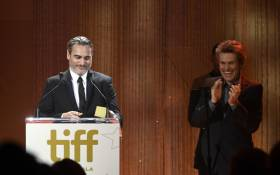 Willem Dafoe presents the TIFF Tribute Actor Award to Joaquin Phoenix onstage during the 2019 Toronto International Film Festival TIFF Tribute Gala at The Fairmont Royal York Hotel on 9 September 2019 in Toronto. Picture: AFP