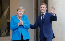 German Chancellor Angela Merkel (L) and French President Emmanuel Macron pose prior to a meeting and a working dinner at the Elysee Palace in Paris on 16 September 2021. Picture: Ludovic Marin/AFP