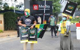 ANC members protest outside the eNCA head office in Hydepark following claims of racism against the media house's senior journalist Lindsay Dentlinger on 2 March 2021. Picture: @MYANC/Twitter