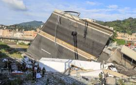 Rescuers work at the site where the Morandi motorway bridge collapsed in Genoa on 14 August, 2018. Picture: AFP