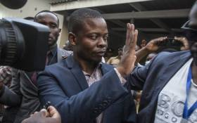 Malawian preacher Shepherd Bushiri waves at sympathisers as he leaves the Lilongwe Magistrates Court on 19 November 2020, after skipping bail in South Africa and arrested in Malawi. Picture: AFP