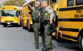 LA County sheriff's deputies keep watch near Saugus High School after a shooting at the school left two students dead and three wounded on 14 November 2019 in Santa Clarita, California. Picture: AFP