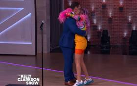 A YouTube screengrab shows John Cena and Show Madjozi on The Kelly Clarkson Show.