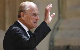 FILE: Britain's Prince Philip, Duke of Edinburgh waves as he takes part in the transfer of the Colonel-in-Chief of The Rifles at Windsor castle in Windsor on 22 July 2020. Picture: Adrian DENNIS/POOL/AFP