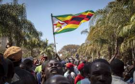 FILE: Protesters marched from the MDC headquarters to the ZEC office at Rainbow Towers, Harare, to protest against the election process on 1 August 2018. They were met by riot police armed with rubber bullets, tear gas, and AKs. Picture: Thomas Holder/EWN