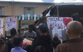 Neighbours, friends, relatives and classmates gather outside Tazne van Wyk's home in Elsies River after news of her death came to light on 20 February 2020. Picture: Lizell Persens/EWN