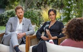 This undated image released March 7, 2021 courtesy of Harpo Productions shows Britain's Prince Harry (L) and his wife Meghan (C), Duchess of Sussex, in a conversation with US television host Oprah Winfrey. Joe Pugliese / Harpo Productions / AFP.