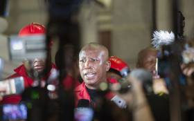 Julius Malema, leader of the Economic Freedom Fighters (EFF), speaks to members of the media after the EFF disrupted the State of the Nation Address and then decided to leave before South African President Cyril Ramaphosa delivered his address, at the opening of the South African Parliament in Cape Town on 13 February 2020. Picture: AFP