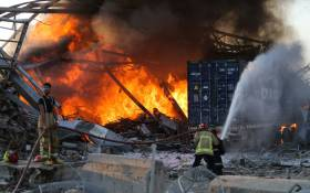 Firefighters douse a blaze at the scene of an explosion at the port of Lebanon's capital Beirut on 4 August 2020. Two huge explosion rocked the Lebanese capital Beirut, wounding dozens of people, shaking buildings and sending huge plumes of smoke billowing into the sky. Picture: AFP
