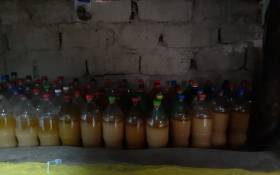 At the scene, members arrested two suspects aged 30 and 44 for selling illegal liquor concoctions and also confiscated over 300 litres of this illicit brew.  Picture: SAPoliceService/Facebook