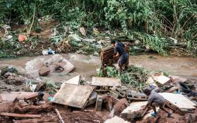 A man tries to salvage some of his furniture at an informal settlement of BottleBrush, south of Durban, after torrential rains and flash floods destroyed his home on 23 April 2019. Picture: AFP