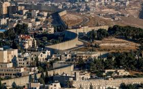This picture taken on June 30, 2020 shows a view of Israel's controversial separation barrier between the West Bank city of Abu Dis (L) and East Jerusalem (R). Picture: AFP.