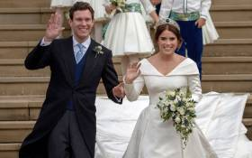 Britain's Princess Eugenie of York (R) and her husband Jack Brooksbank wave as they emerge from the West Door of St George's Chapel, Windsor Castle, in Windsor, on October 12, 2018 after their wedding ceremony. Picture: AFP.