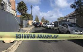 Police and forensic experts comb the scene of a shooting after prominent advocate Pete Mihalik was gunned down outside a Cape Town school on 30 October 2018. Picture: Kaylynn Palm/EWN