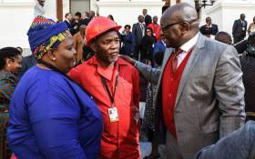 Premier of Gauteng David Makhura congratulating Kenny Motsamai after being sworn in as a member of the NCOP. Picture: @EFFSouthAfrica/Twitter.