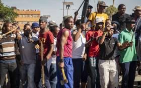 Zulu hostel dwellers in Jeppestown gather before Bheki Cele arrives to address them on 3 September 2019. Picture: Thomas Holder/EWN