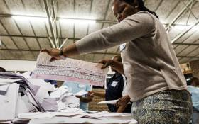 FILE: An IEC electoral officer counts ballot papers at the Addington Primary School after voting ended in the sixth national general elections in Durban on 8 May 2019. Picture: AFP