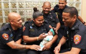 Firefighters pictured with baby Bronlyn-Lee. Picture: Supplied