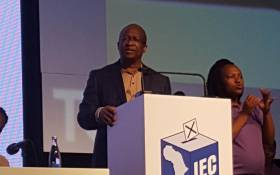 Chief electoral officer Sy Mamabolo gives an update on the voting process at the national results operation centre in Pretoria. Picture: @GovernmentZA/Twitter