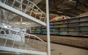 FILE: A picture shows empty shelves, including those for bread, in a grocery store in Harare on 9 October 2018, as Zimbabwe is experiencing renewed shortages. Picture: AFP