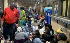 Foreign nationals wait at the UN Refugee Agency office in Cape Town for assistance in leaving South Africa on 9 October 2019. Picture: Kaylynn Palm/EWN
