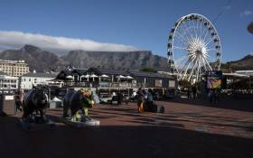 FILE: A view of the V&A Waterfront in Cape Town on 28 April 2021. The venue usually attracts millions of visitors every year but is now sparsely populated due to regulations related to the coronavirus pandemic. Picture: Rodger Bosch/AFP