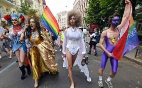 Waving rainbow and Ukrainian flags, dressed in bright colours, LGBTQIA+ members marched through the centre of the capital on 23 June 2019, as thousands of police and National Guards stood by to ensure order. Picture: AFP