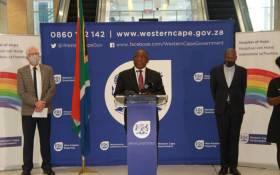 President Cyril Ramaphosa, flanked by Western Cape Premier Alan Winde (left) and Health Minister Zweli Mkhize (right), addresses officials during his inspection of the Cape Town International Convention Centre (CTICC) coronavirus field hospital on 5 June 2020. Picture: @alanwinde/Twitter