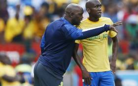 Mamelodi Sundowns head coach Pitso Mosimane (L) instructs defender Anele Ngcongca(R) during the ABSA Premier Soccer League on 27 October 2019. Picture: Phill Magakoe / AFP