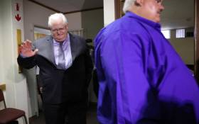 Andries van Tonder and Angelo Agrizzi arrive at the Specialised Commercial Crimes Court in Pretoria on 6 February 2019. The pair and five others have been charged with corruption, money laundering and fraud. Picture: Abigail Javier/EWN.