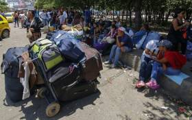 Venezuelans rest after crossing the border from San Antonio del Tachira in Venezuela into Cucuta, in Norte de Santander Department, Colombia, through the Simon Bolivar international bridge on 19 August, 2018. Picture: AFP.