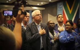 DA Western Cape premier candidate Alan Winde and his team sing the National Anthem following the  final media briefing by the IEC at the Western Cape Results Centre. Picture: Cindy Archillies/EWN