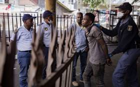 Police make an arrest in Hillbrow, Johannesburg during day one of the coronavirus lockdown on 27 March 2020. Picture: Sethembiso Zulu/EWN