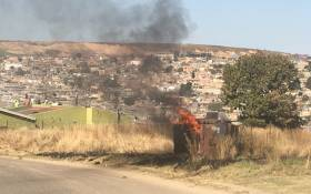 A house and a transformer in Gousblom in Marlboro Gardens have been torched following demolition of shacks. Picture: Robinson Nqola/EWN.