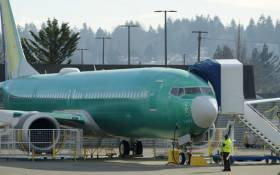 FILE: A Boeing 737 MAX airplane test its engines outside of the company's factory on 11 March 2019 in Renton, Washington. Picture: AFP