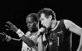 South African singer Johnny Clegg (R) and dancer Dudu Zulu of South African band Savuka perform on stage at the Amnesty International Concert on October 10, 1988 in Abidjan. Picture: AFP