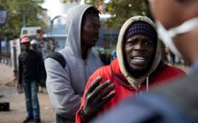 A homeless man explains to police about how he cannot sleep in the streets without blankets. Picture: Ahmed Kajee/EWN