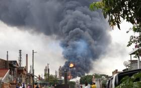 The refinery is engulfed in flames and smoke can be seen from a great distance. Picture: Riosha Kuar