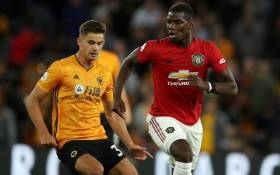 Manchester United's Paul Pogba (right) is chased down by a Wolverhampton Wanderers player during their English Premier League match on 19 August 2019. Picture: @ManUtd/Twitter