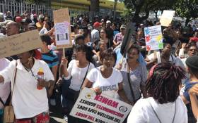 Community members protest outside the Goodwood magistrates court on 21 February 2020 where the man accused of murdering Tazne van Wyk (8) appear. Picture: Lauren Isaacs/EWN