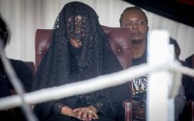 Robert Mugabe's family including his wife, Grace (veiled,) sits and watches on as members of the public view the body of the former president. Picture: Thomas Holder/Eyewitness News.