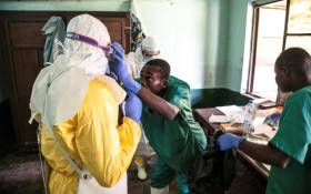 In this handout photograph released by Unicef on 13 May 2018, health workers wear protective equipment as they prepare to attend to suspected Ebola patients at Bikoro Hospital - the epicentre of the latest Ebola outbreak in the Democratic Republic of Congo. Picture: AFP.
