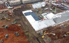 This aerial photo shows excavators and trucks at the construction site of a new hospital being built to treat patients from the deadly coronavirus outbreak in Wuhan in China's central Hubei province on 27 January 2020. Picture: AFP