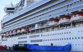 Japanese military personnel set up a covered walkway next to the Diamond Princess cruise ship, with around 3,600 people quarantined onboard due to fears of the new coronavirus, at the Daikoku Pier Cruise Terminal in Yokohama port on 10 February 2020. Picture: AFP