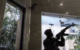 A security officer secures the building attached to the DusitD2 hotel in Nairobi, on January 15, 2019, after a blast followed by a gun battle rocked the upmarket hotel complex. Picture: AFP