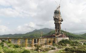 """This file photo taken on 25 August, 2018 shows the under-construction """"Statue Of Unity"""", a monument dedicated to Indian independence leader Sardar Vallabhbhai Patel, overlooking the Sardar Sarovar Dam near Vadodara in India's western Gujarat state. Picture: AFP"""