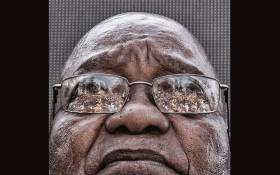 FILE: The crowd who gathered to support former President Jacob Zuma is seen reflected in his glasses as he waits to speak after appearing on corruption charges at the Durban High Court on 6 April 2018. Picture: EWN.
