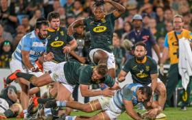 South Africa centre Frans Steyn (L) attempts to stop Argentina Captain and flanker Pablo Matera (C) from scoring a try during their 2019 Rugby Union World Cup warm-up test match between South Africa against Argentina at the Loftus Versfeld Stadium in Pretoria, on 17 August 2019. Picture: AFP.