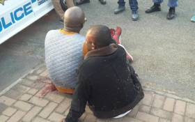 Two suspects were arrested in Rosettenville after a brief shootout with police after they were cornered following a truck hijack on 23 July 2015. Picture: SAPS.